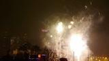 Fireworks over city building at night,bridge,viaduct,street-light Footage