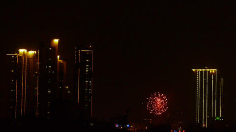 Fireworks over city building at night Footage