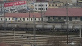 Long tank train traveling on railway in china,After railway station Footage