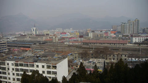 bird's eye view of railway station of Tai'an city in China.Taishan Mountain Footage