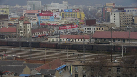 Long goods train traveling on railway at Taian City near Mountain Tai,After rail Footage