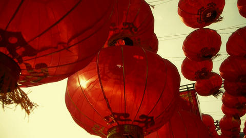 Red lanterns tassel swaying in wind,behind sun,elements... Stock Video Footage