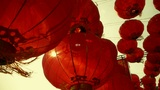 Red lanterns tassel swaying in wind,behind sun,elements of East,china new year Footage