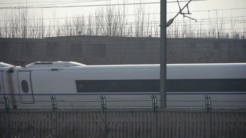 White high-speed train between the wire Live Action