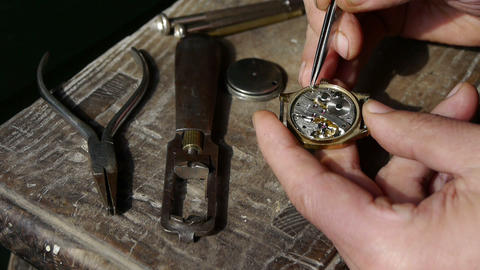 Mounting screw of watch on wood desk,A lot of tools Stock Video Footage