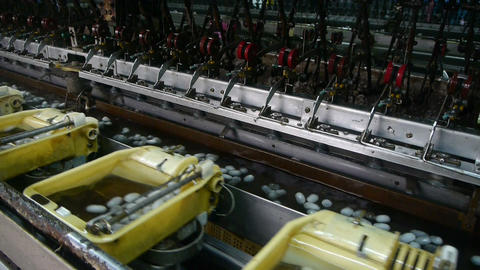Silkworm cocoon at reeling silk factory.Workshop Stock Video Footage