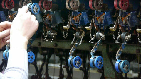 Reeling machine and Textile-machine in operation.Workers reeling at workshop Footage