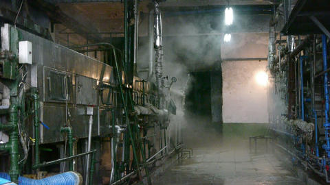 Factory filled with steam.dim light,Valve,Pipeline,Boiler Stock Video Footage