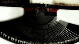 Hands typing on a typewriter to play the characters I love you Footage