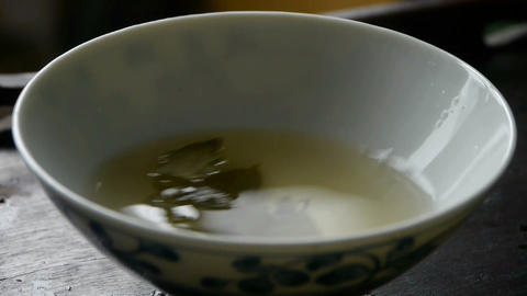 A bowl of shaking tea.china,japan,water,steaming Stock Video Footage