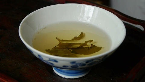 A bowl of steaming tea.china,japan,water,steaming Stock Video Footage