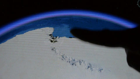 touch globe map on ipad,drag to arctic&antarctic,many... Stock Video Footage