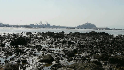Island of QingDao city.Warship moored in port,reef Stock Video Footage