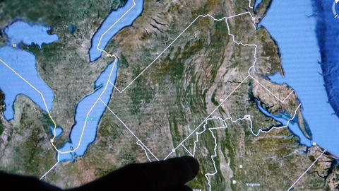 touch globe gps map on ipad,drag to American United States Stock Video Footage