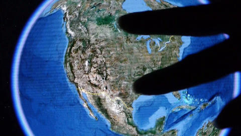 touch globe map on ipad,enlarged to Washington city of... Stock Video Footage