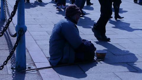 Beggar woman sitting on ground Stock Video Footage
