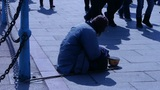 Beggar Woman Sitting On Ground stock footage