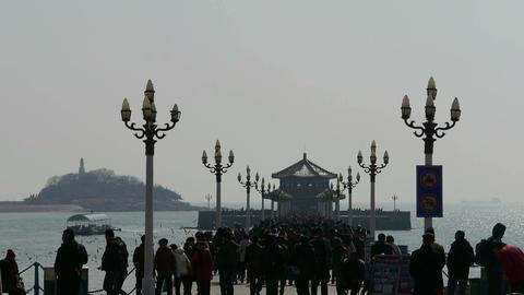 Many people at Qingdao pier of Qingdao Seaside Stock Video Footage