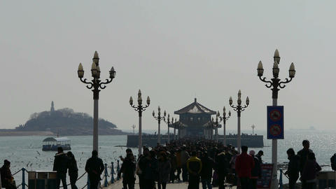Many people at Qingdao pier of Qingdao Seaside Stock Video Footage