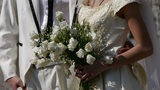 Groom and bride together,Bride carrying a bouquet of flowers Footage