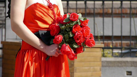 Bride wearing a red wedding dress,carrying a bouquet of... Stock Video Footage