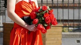 Bride wearing a red wedding dress,carrying a bouquet of rose flowers Footage