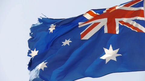 Australian flag flutters in wind Stock Video Footage
