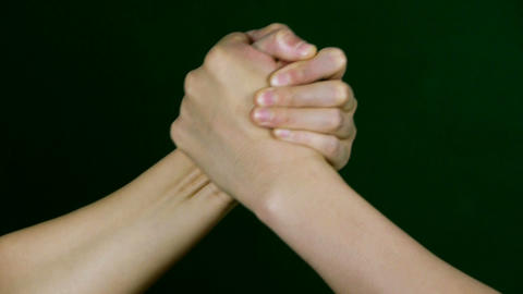 Two people in hand wrestling game Stock Video Footage