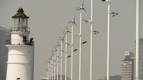 lighthouse and wind turbine & new power energy city Stock Video Footage