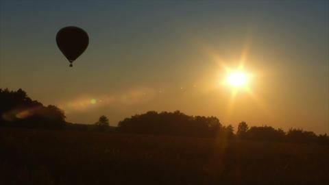 10713 hot air balloon up in sundown Stock Video Footage