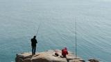 Man fishing on reef Footage
