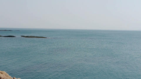 Ocean water surface and rock reef coastal,horizon,skyline Footage