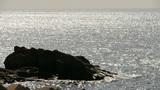 Sparkling water surface and rock reef coastal,horizon,skyline,sunrise,silver Footage