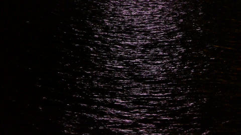 Water ripples reflection at night Footage