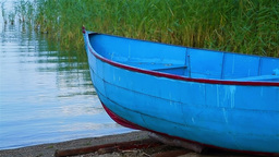 Detail of small fishing boat on lake coastline Stock Video Footage