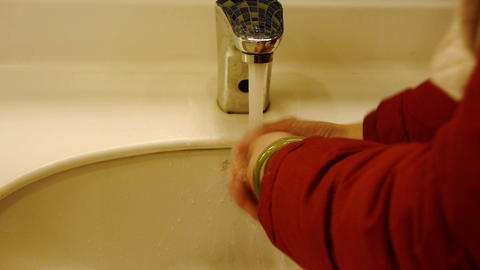 Wash hands at Luxurious faucets toilets Stock Video Footage