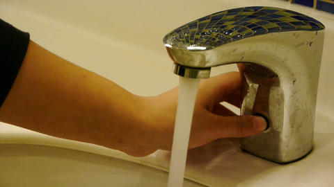 Turn on tap valve,Wash hands at Luxurious faucets toilets Footage