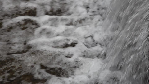 Torrent of water flowing over a waterfall rounded of concrete 23 Footage