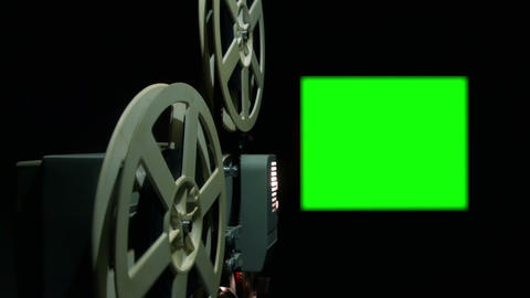 Close Up Of An Old Projector With A Green Screen stock footage