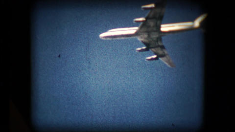 Scene of a plane flying overhead in the mid 1960's Live Action