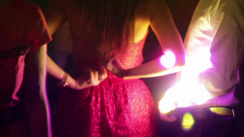 Revelers Dancing At A Private Party In Light Of A Reflector 8522 stock footage
