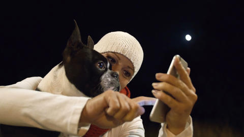 Woman and Dog Looking at Smartphone Screen Footage