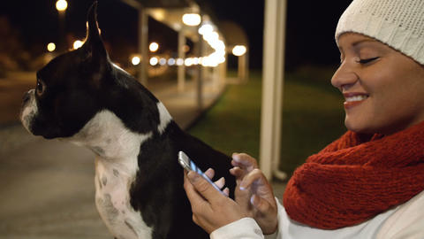 Woman Looking at Smartphone with Dog Footage
