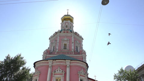 Epiphany Monastery facade and tower from front side, sun shine behind onion dome Footage