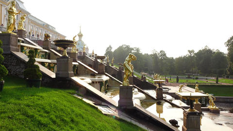 Slide shot of Grand Cascade in Peterhof royal park, sunny evening time Footage