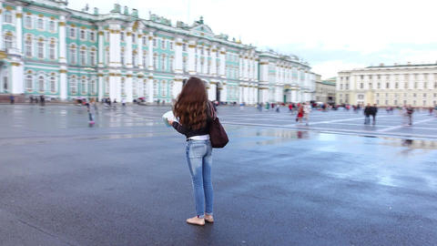 Young cheery tourist woman admire city sights, fast orbiting camera move around Footage