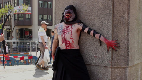 The Facelift Monster posing in a public square - slow motion Footage
