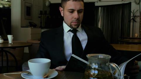 Businessman browses the menu Footage