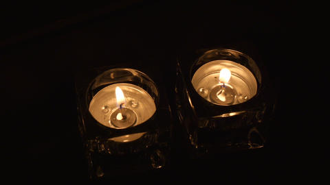 Wide shot two tealight holders in evening Footage