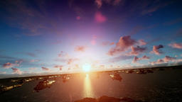 Military helicopters cruising above ocean, sunrise Animation